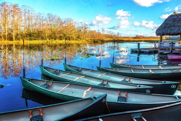 Photograph - Canoes At Sunset by Debra and Dave Vanderlaan