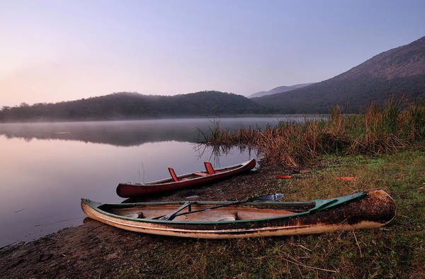 Wall Art - Photograph - Canoes Drawn Up On The Shore With Mist by Emil Von Maltitz