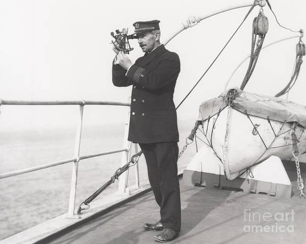 Naval Wall Art - Photograph - Captain Navigating Ship by Everett Collection