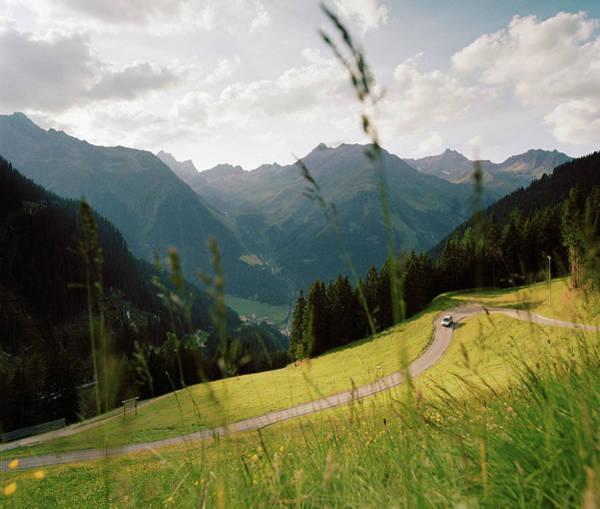 Driving Photograph - Car Driving Along A High Alpine Road by Cultura Exclusive/philip Lee Harvey