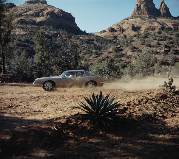 Dust Photograph - Car Driving Through Dirt Road by Tom Kelley Archive