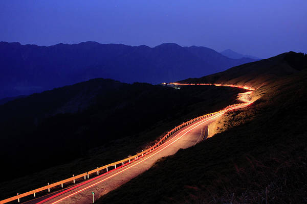 Wall Art - Photograph - Car Light Trail In Mountain Highway by Samyaoo