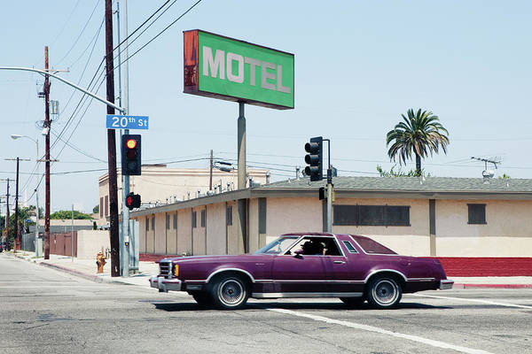 Kitsch Photograph - Car Passing Motel In Los Angeles by Michael Wells
