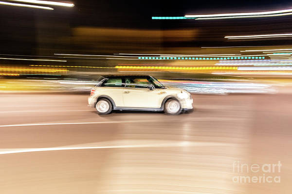 Photograph - Car Rolling At Full Speed Through The City At Night, Image Of Panning, With Defocused Background Lights. by Joaquin Corbalan