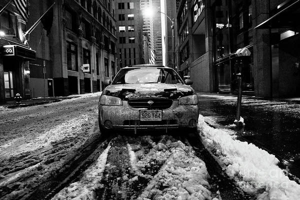 Photograph -  Car With Ice And Snow Parked On The Street. by Joaquin Corbalan