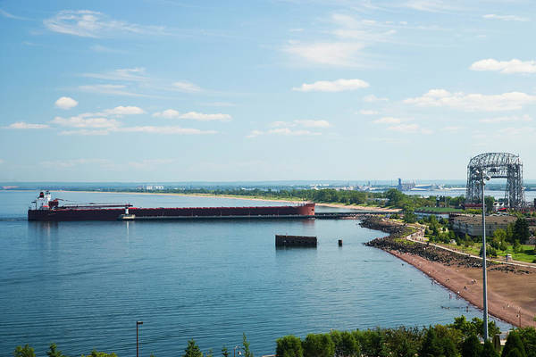 Lake Superior Photograph - Cargo Ship Entering Harbor In Duluth by Jimkruger