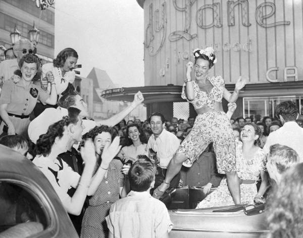 Indigenous People Photograph - Carmen Miranda Dancing On Back Seat Of by Bettmann