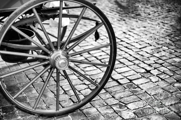 Photograph - Carriage Wheel At Piazza Navona In Roma by John Rizzuto