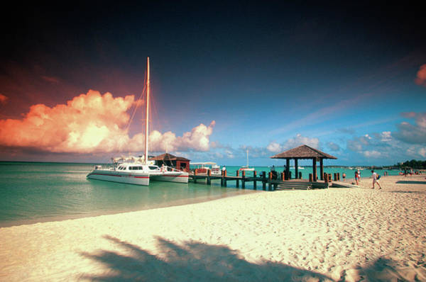 Palm Beach Photograph - Catamaran Docked At Pier At Sunset On by Medioimages/photodisc