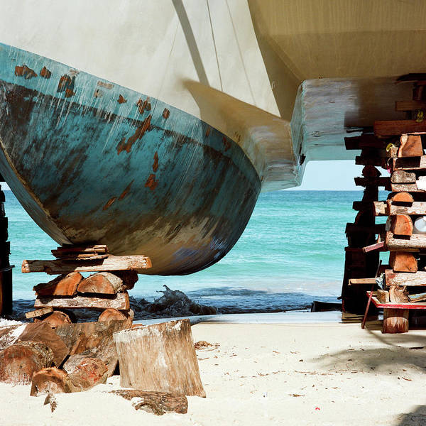 Square Mile Wall Art - Photograph - Catamaran Repair On Beach In Jamaica by Joseph X. Burke Analog Photography