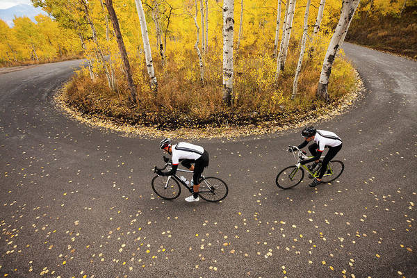 Adult Male Photograph - Caucasian Cyclists On Rural Road by Blend Images - Mike Kemp