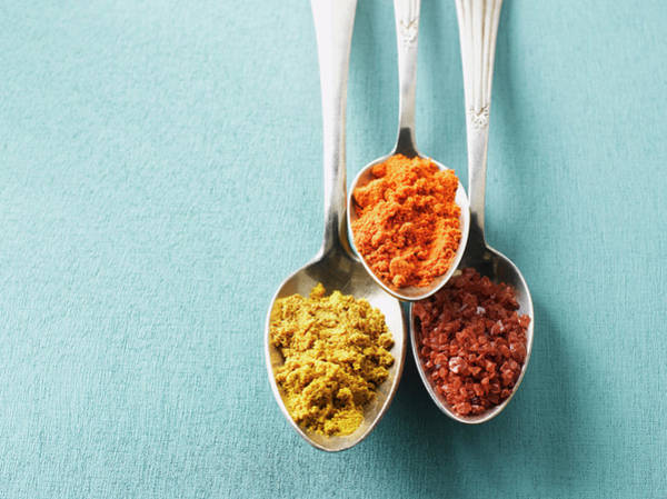 Blue Spoon Photograph - Cayenne Pepper, Curry Powder And Rock by Westend61