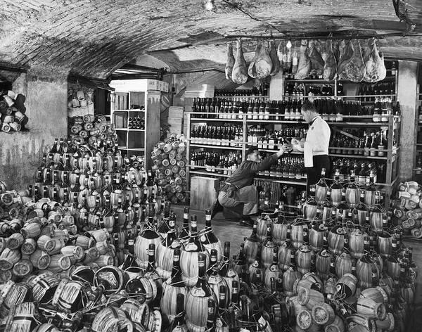 Waiter Photograph - Cellarman At Gianninos Handing Bottle by Alfred Eisenstaedt