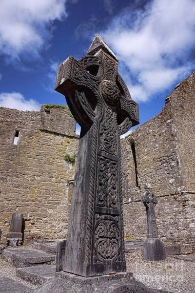 Wall Art - Photograph - Celtic Cross And Irish Ruins by Olivier Le Queinec