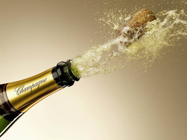 Celebration Photograph - Champagne And Cork Exploding From Bottle by Andy Roberts