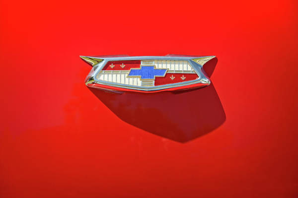 Vehicles Wall Art - Photograph - Chevrolet Emblem On A 55 Chevy Trunk by Scott Norris