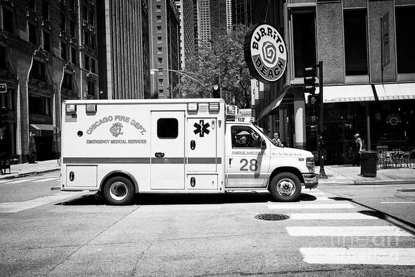 Wall Art - Photograph - Chicago Fire Department Emergency Ambulance On Call In Downtown Chicago Il Usa by Joe Fox