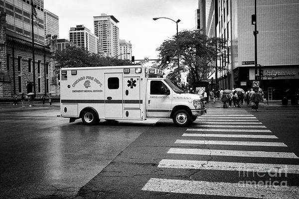 Wall Art - Photograph - Chicago Fire Department Emergency Ambulance On Call On A Wet Day In Downtown Chicago Il Usa by Joe Fox