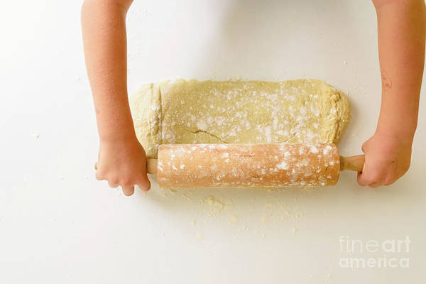 Wall Art - Photograph - Child Kneading The Dough Of A Pizza, Viewed From Above. by Joaquin Corbalan