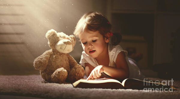 Male Photograph - Child Little Girl Reading A Magic Book by Evgeny Atamanenko