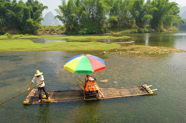 Sunshade Photograph - Chinese Tourists In Bamboo Raft At by Nancy Brown