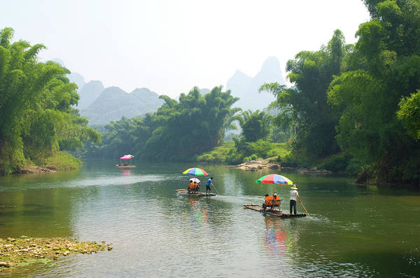 Sunshade Photograph - Chinese Tourists In Bamboo Rafts At by Nancy Brown