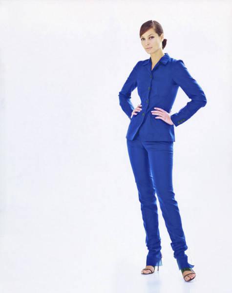 Christy Photograph - Christy Turlington Wearing A Blue Pantsuit by Arthur Elgort