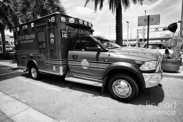 Wall Art - Photograph - city of orlando fire department emergency ambulance Orlando Florida USA by Joe Fox
