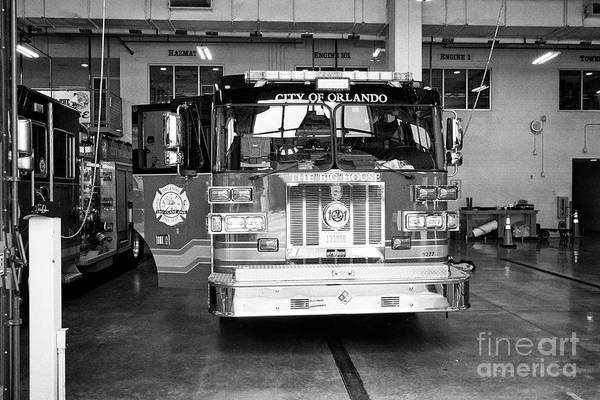 Wall Art - Photograph - city of orlando fire department fire truck in station ready to go Orlando Florida USA by Joe Fox