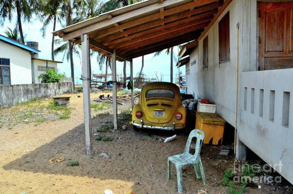 Four Wheeler Photograph - Classic German Volkswagen Beetle Yellow Car Parked Under Shelter In Pattani Thailand by Imran Ahmed