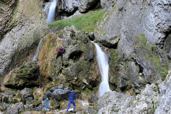 Wall Art - Photograph - Climbers Making Their Way Up The Cliffs Of Gordale Scar by Louise Heusinkveld