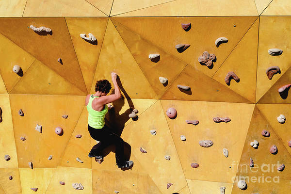 Photograph - Climbing Wall With Strong Woman In Good Shape Doing Exercise Outdoors by Joaquin Corbalan
