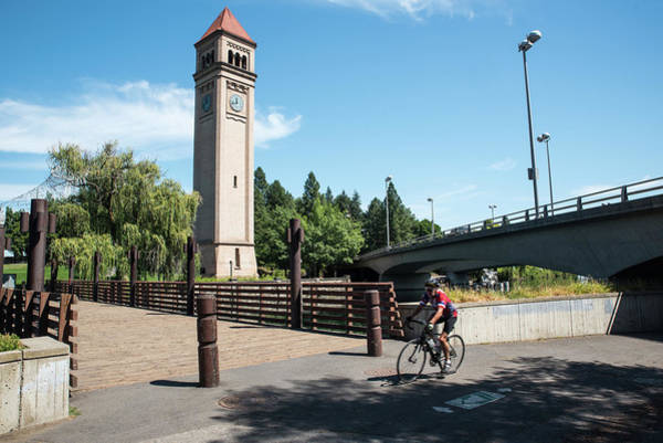 Wall Art - Photograph - Clocktower Bridges And Cyclist by Tom Cochran