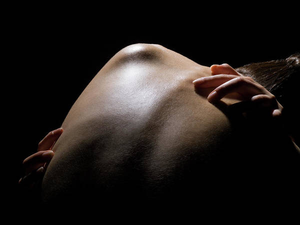 Black Background Photograph - Close Up Of A Females Shoulder by Michael H