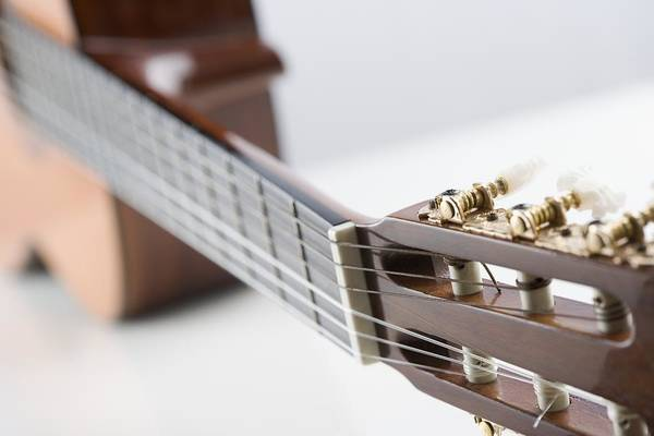 Wall Art - Photograph - Close-up Of A Guitar by Jamie Grill