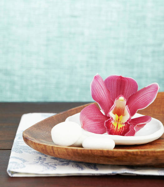 Bleached Photograph - Close Up Of A Pink Orchid On Wooden Tray by Gspictures