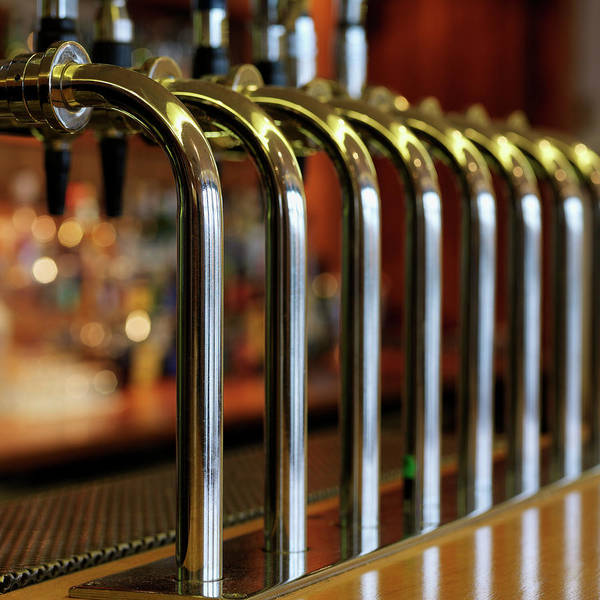Beer Tap Photograph - Close-up Of Bar Taps by Stockbyte
