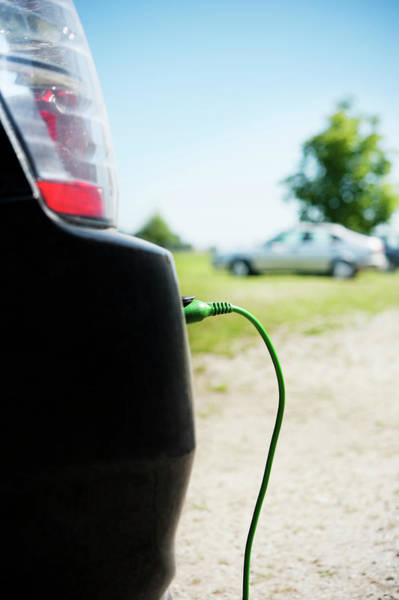 Skane Photograph - Close Up Of Electric Car Charging by Johner Images
