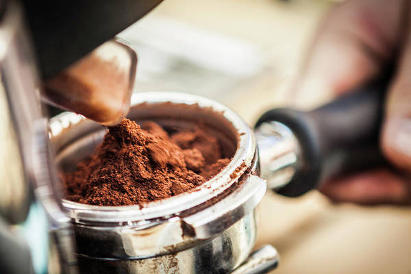 Ground Photograph - Close Up Of Espresso Grounds In Machine by Manuel Sulzer