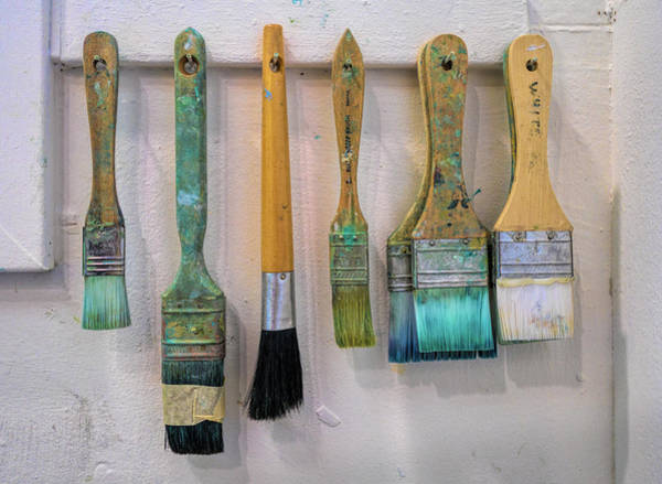 Wall Art - Photograph - Close-up Of Paint Brushes Hanging by Panoramic Images