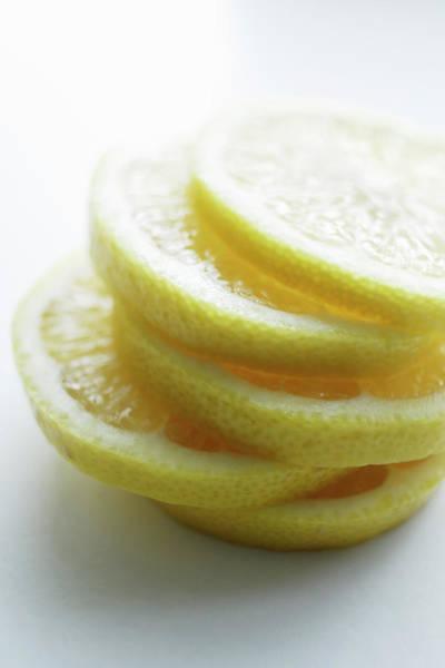 Lemon Photograph - Close Up Of Slices Of Lemon by Brett Stevens