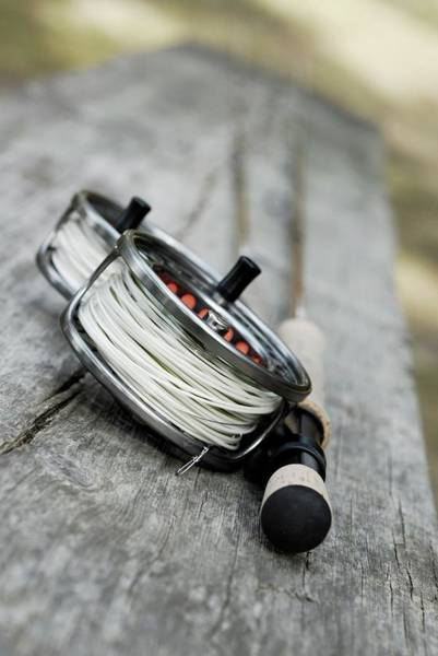 Wall Art - Photograph - Close-up Of Two Fishing Reels And A by Glowimages