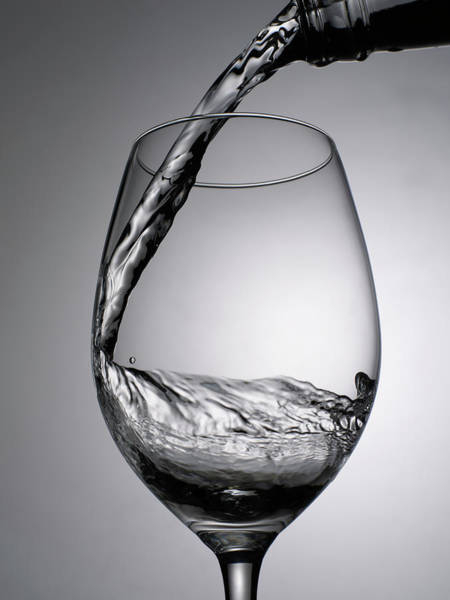 Drinking Glass Photograph - Close Up Of Wine Being Poured Into Wine by Johner Images