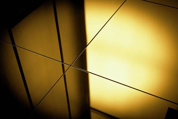 Wall Art - Photograph - Close-up Spot Lit Reflection In Yellow by Ralf Hiemisch