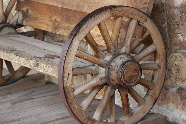 Photograph - Closeup Of Wagon Wheel Bench by Colleen Cornelius