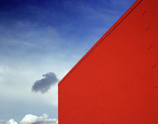 Photograph - Cloud Floating Through Blue Sky Over by Zeb Andrews