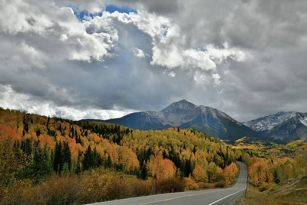 Photograph - Clouds Break Over Fall Colors Along Highway 145 by Ray Mathis