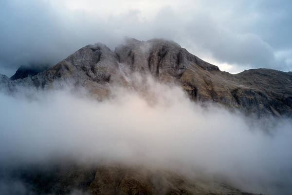 Photograph - Clouds In The Dolomites by Jon Glaser