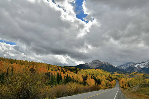 Photograph - Clouds Split Open Over Highway 145 Fall Colors by Ray Mathis