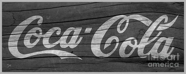 Wall Art - Photograph - Coca Cola Sign On Weathered Wood Black And White by John Stephens